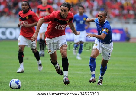 KUALA LUMPUR - JULY 18 : Berbatov of Manchester United team in action during friendly match against Malaysia at National Stadium, July 18, 2009 in Kuala Lumpur.  Manchester won 3-2.