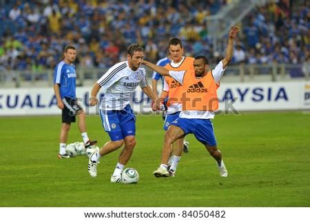 KUALA LUMPUR, JULY 21 : Chelsea's Frank Lampard (in white) Josh McEachran (center) Jose Bosingwa (R)  warm-up during a preseason match against Malaysia on July 21, 2011 in Kuala Lumpur, Malaysia.