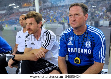 KUALA LUMPUR, JULY 21:Chelsea's manager Andre Villas-Boas (C) Roberto Di Matteo (L) Steve Holland (R) sitting on bench during a preseason match against Malaysia on July 21, 2011 in Kuala Lumpur