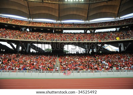 KUALA LUMPUR - JULY 18 : Fan of Manchester United team during friendly match against Malaysia at National Stadium, July 18, 2009 in Kuala Lumpur.  Manchester won 3-2. - stock photo