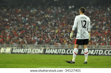 KUALA LUMPUR - JULY 20 : Goalkeeper Ben Foster of Manchester United (MU) in action at MU friendly match against Malaysia XI team at National Stadium July 20, 2009 in Kuala Lumpur. MU won 2-0.