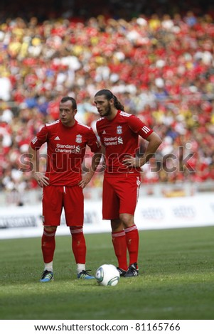 KUALA LUMPUR - JULY 16 : Liverpool football club players Charlie Adam (L) and Andy Carroll at a friendly match against Malaysia XI on July 16, 2011 in Kuala Lumpur, Malaysia. Liverpool won 6-3.