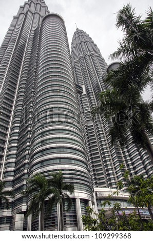 KUALA LUMPUR - JULY 20: Petronas Towers is one of the most popular visitor attractions in Malaysia.  The famous landmark is the world's tallest twin tower, on  July 20, 2012 in Kuala Lumpur.