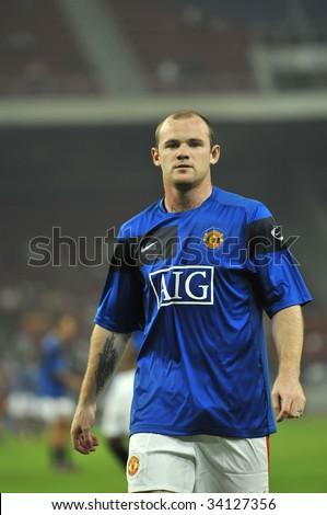 KUALA LUMPUR - JULY 20 : Wayne Rooney of Manchester United (MU) warms up before MU friendly match against Malaysia XI team at National Stadium, Bukit Jalil July 20, 2009 in Kuala Lumpur. MU won 2-0.