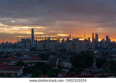 Kuala Lumpur landmark, evening landscape, building and residency development in crowd population. dusk scenery of town.