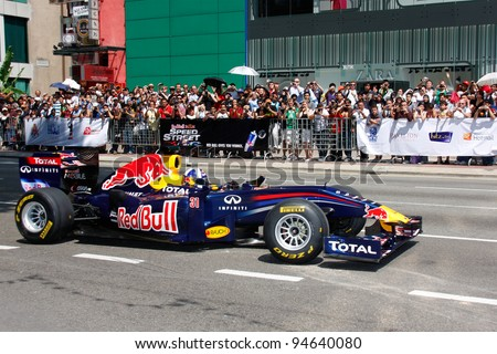 KUALA LUMPUR, MALAYSIA-APR 3:Former Red Bull F1 driver David Coulthard steers his car during a street demonstration Apr 3, 2011 in Kuala Lumpur.The event is a promotion for F1 Malaysia Grand Prix 2011