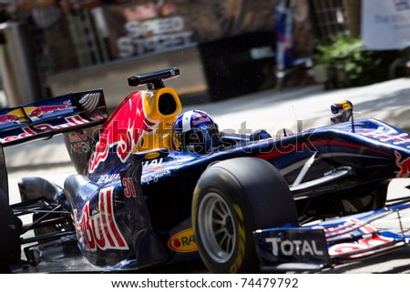 KUALA LUMPUR, MALAYSIA - APRIL 3: Close up of Scottish David Coulthard at a Red Bull F1 demo in conjunction with the Petronas Formula 1 Grand Prix on April 3, 2011 in Kuala Lumpur, Malaysia