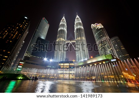 KUALA LUMPUR, MALAYSIA - APRIL 13: Fountain show of Petronas Twin Towers on April 13, 2013, Kuala Lumpur Malaysia. Petronas Twin Towers were the tallest buildings (452m) in the world during 1998-2004.