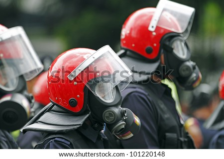 KUALA LUMPUR, MALAYSIA - APRIL 28: Riot police with gas mask at the protest rally organized by the coalition for clean and fair election on April 28, 2012 in Dataran Merdeka, Kuala Lumpur, Malaysia.
