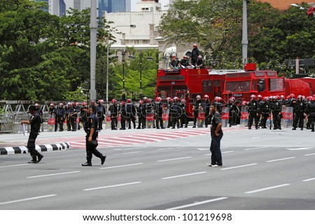KUALA LUMPUR, MALAYSIA - APRIL 28: Riot police with water cannon at the protest rally by the coalition for clean and fair election on April 28, 2012 in Dataran Merdeka Jln Raja, Kuala Lumpur, Malaysia