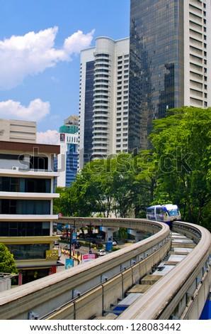 KUALA LUMPUR, MALAYSIA -AUG 19: KL Monorail on Aug 19, 2011 in Kuala Lumpur, Malaysia. Train arrives at a train station. Kuala Lumpur metro or rapid transit system consists of 6 metro lines.