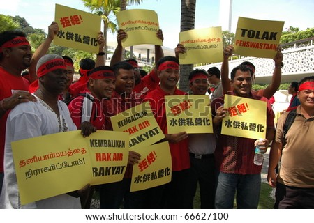 KUALA LUMPUR, MALAYSIA - DEC 5: Protesters in red protest against the water tariff hike in Kuala Lumpur, Malaysia, December 5, 2010.