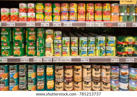 KUALA LUMPUR, MALAYSIA - DECEMBER 22, 2017: Canned beans, corn and vegetables are displayed in a supermarket shelf in Malaysia #785213737