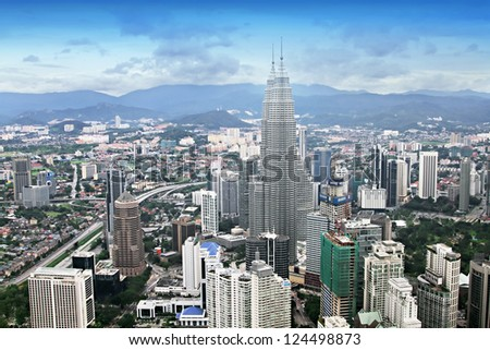 KUALA LUMPUR, MALAYSIA - DECEMBER 18: Petronas Twin Towers panorama at morning on December 18, 2010 in Kuala Lumpur, Malaysia. Petronas Towers were the tallest buildings in the world from until 2004