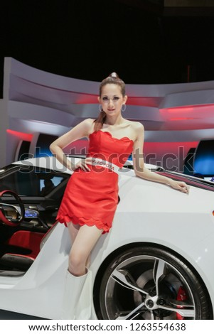 Kuala Lumpur, Malaysia - December 2010 : Unidentified model posed for photograph with new Toyota car during exhibition of Kuala Lumpur International Motorshow 2010