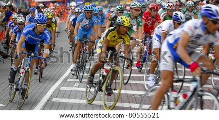 KUALA LUMPUR, MALAYSIA-FEB 12: An unidentified group of cyclists in action at the final stage of  le Tour de Langkawi on February 12, 2006 in Kuala Lumpur. 119 cyclists took part in this yearly event.