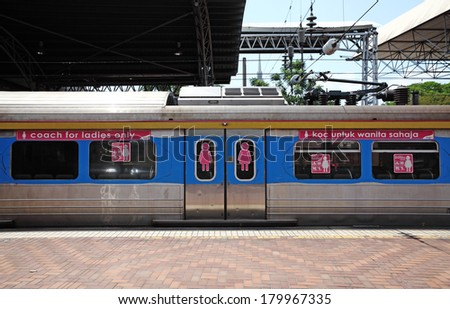 KUALA LUMPUR, MALAYSIA - FEB 23, 2014: Facade of a Malaysian train coach reserved for ladies in Kuala Lumpur Railway Station. The service was introduced in 2010 after spate of sexual attack on woman.