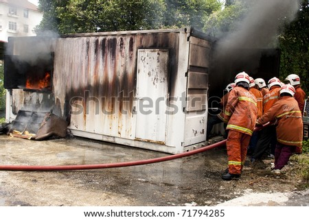 KUALA LUMPUR, MALAYSIA - FEB 23:  Participants with the guidance from Fire and Rescue Department putting out a fire during a Fire Awareness and Safety Day on February 23, 2011 in Kuala Lumpur Malaysia