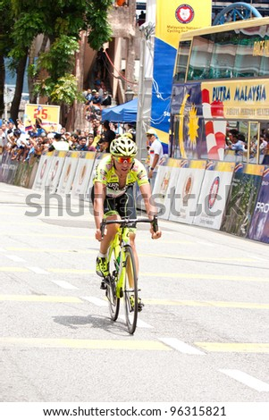 KUALA LUMPUR, MALAYSIA - FEB 28: Unidentified cyclist competes in Stage 5 of the le Tour de Langkawi (LTdL) from Ayer Keroh to Pandan Indah on Feb 28, 2012 in Kuala Lumpur, Malaysia.