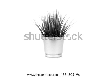 KUALA LUMPUR, MALAYSIA - February 25, 2019: An artificial grass in metal vase of IKEA Store Malaysia product. Black and White #1334305196