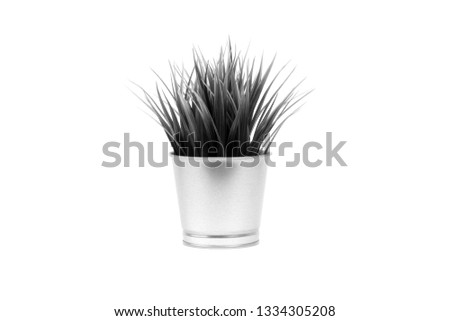 KUALA LUMPUR, MALAYSIA - February 25, 2019: An artificial grass in metal vase of IKEA Store Malaysia product. Black and White #1334305208