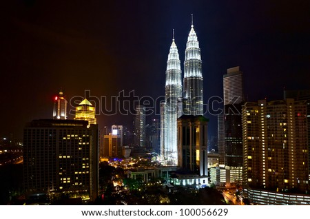 KUALA LUMPUR, MALAYSIA - FEBRUARY 28: Night view of The Petronas Twin Towers on February 28, 2012 in Kuala Lumpur. The skyscraper (451.9m/88 floors) is the tallest twin buildings in the world.