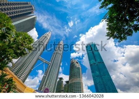 Kuala Lumpur, Malaysia - February 02 2019: Petronas Towers and KLCC.Petronas Towers is a high-rise building in Kuala Lumpur, Malaysia.This tower was built in 1998.height is 452 m. #1366042028