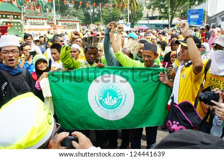 KUALA LUMPUR, MALAYSIA - JANUARY 12: Protesters holding signs at the protest rally organized by NGO and fair election on January 12, 2013 in Stadium Merdeka, Kuala Lumpur, Malaysia.