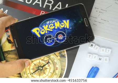 KUALA LUMPUR, MALAYSIA - JULY 13, 2016 : An Android user plays Pokemon Go after study 2 hour, a free-to-play augmented reality mobile game developed by Niantic for iOS and Android devices.