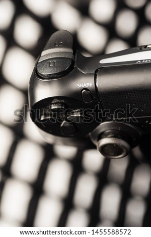 Kuala Lumpur, Malaysia - July 2019. Closed up shot of Playstation 4 Dualshock controller. Playstation 4 is the most popular gaming console.  #1455588572