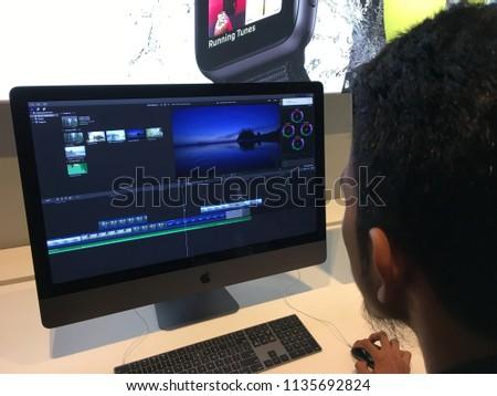 KUALA LUMPUR,MALAYSIA - 9 June 2018: A man trying Apple iMac Pro and using Final Cut Pro X at Apple Store in Suria KLCC #1135692824