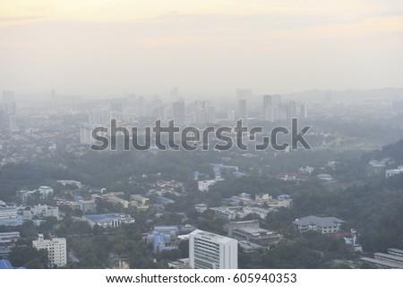 Kuala Lumpur,Malaysia-March 04,2017: Aerial view of Kuala Lumpur cityscape at dusk and foggy day. #605940353