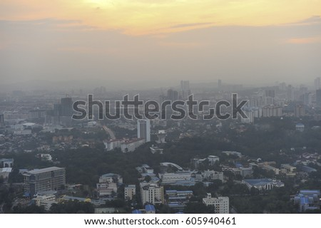 Kuala Lumpur,Malaysia-March 04,2017: Aerial view of Kuala Lumpur cityscape at dusk and foggy day. #605940461