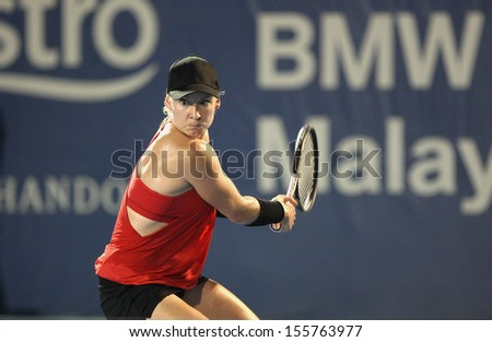 Kuala Lumpur, Malaysia, March 02 2013: American Bethanie Mattek-Sands returns a shot to Czech Karolina Pliskova during the final match of the WTA Malaysian Open tennis tournament - stock photo