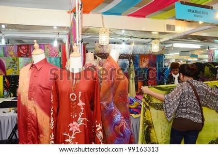 KUALA LUMPUR, MALAYSIA - MARCH 30: Exhibition batik by traders during National Craft Day 2012 at the Kuala Lumpur Craft Complex on March 30, 2012 in Kuala Lumpur, Malaysia - stock photo