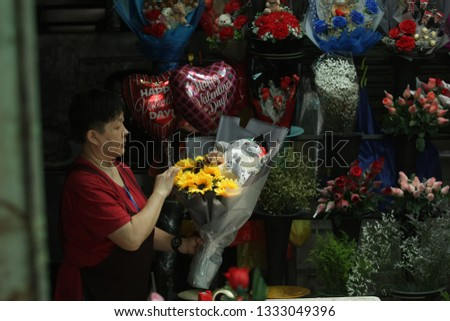 Kuala Lumpur, Malaysia-March 08, 2019. Florist, Kathy Ching runs a business selling fresh flowers at his shop in the Indian Mosque, Kuala Lumpur.