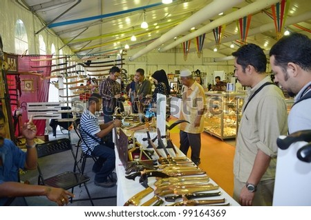 KUALA LUMPUR, MALAYSIA - MARCH 30: Goods and souvenirs sold by exhibitors during the exhibition of the National Craft Day 2012 at the Kuala Lumpur Craft Complex on March 30, 2012 in Kuala Lumpur