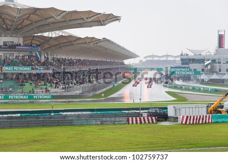 KUALA LUMPUR, MALAYSIA  MARCH 25: Heavy rain during the start at Formula One Grand Prix on March 25, 2012 in Kuala Lumpur, Malaysia. Bolides are ready to continue the race after short break.