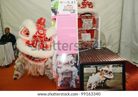 KUALA LUMPUR, MALAYSIA - MARCH 30: Lion dance equipment and accessories on display during National Craft Day 2012 at the Kuala Lumpur Craft Complex on March 30, 2012 in Kuala Lumpur, Malaysia