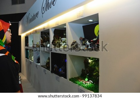 KUALA LUMPUR, MALAYSIA - MARCH 30: Minature Shoe Gallery created by student competition on display at Malaysia International Shoe Festival 2012 Putra World Trade Centre March 30, 2010 in Kuala Lumpur