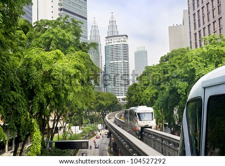 KUALA LUMPUR, MALAYSIA - MARCH 20: Monorail train arrives at a train station on March 20, 2012 in Kuala Lumpur. Kuala Lumpur metro consists of 6 metro lines operated by 4 operators.