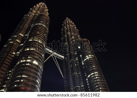 KUALA LUMPUR, MALAYSIA - MARCH 14: Night view of The Petronas Twin Towers on March 14, 2010 in Kuala Lumpur, Malaysia. The skyscraper is the tallest twin buildings in the world.