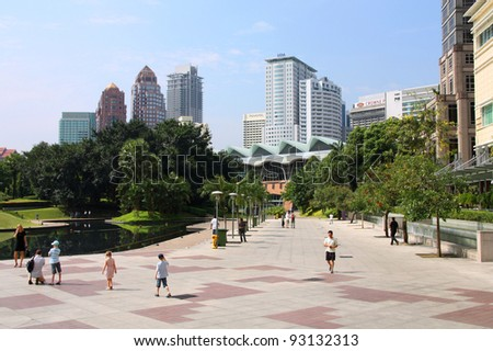 KUALA LUMPUR, MALAYSIA - MARCH 28: Tourists stroll on March 28, 2008 in Kuala Lumpur, Malaysia. In 2010 Kuala Lumpur was the 6th most visited city worldwide with 8.9m international visitors.