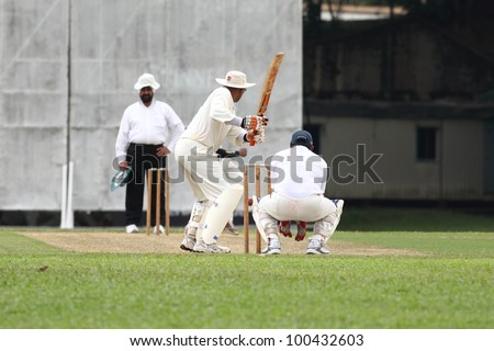 KUALA LUMPUR, MALAYSIA - MARCH 3:Unidentified batsman prepare to hit the ball during a friendly match between Royal Selangor Club and Silver State Cricket Club on March 3,1012 in Kuala Lumpur,Malaysia