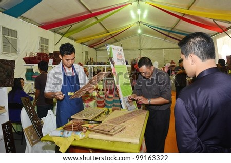 KUALA LUMPUR, MALAYSIA - MARCH 30: Wood carving demonstrations by exhibitors staff during National Craft Day 2012 at the Kuala Lumpur Craft Complex on March 30, 2012 in Kuala Lumpur, Malaysia