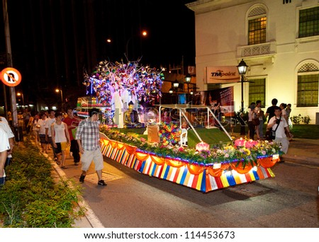 KUALA LUMPUR, MALAYSIA-MAY 5: A beautiful floats parading with its devotees during Wesak Day procession on May 5, 2012 in front the Museum Telecommunication building, Malaysia.