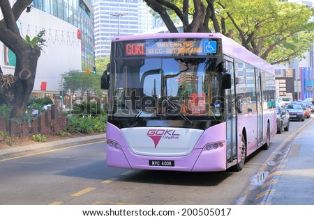 KUALA LUMPUR MALAYSIA - 25 May, 2014:Free public transport GOKL bus runs near Petronas tower. GOKL free bus was launched to improve public mobility in the area of KLCC, Bukit bin tang and china town.