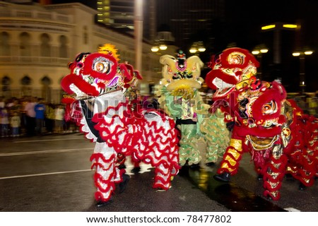 KUALA LUMPUR, MALAYSIA-MAY 21:Malaysian Chinese performing a lion dance at the of Colours of 1 Malaysia May 21 2011 in Kuala Lumpur Malaysia. 24.6million tourist visited Malaysia in 2010.
