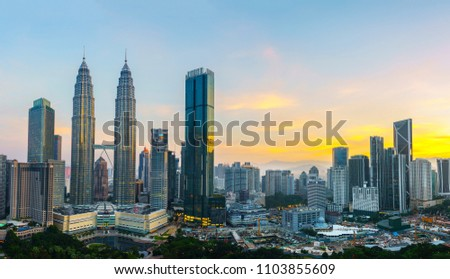 Kuala Lumpur, Malaysia -  May 14,2018 - Petronas Towers and KLCC.Petronas Towers is a high-rise building in Kuala Lumpur, Malaysia.This tower was built in 1998.height is 452 m. #1103855609