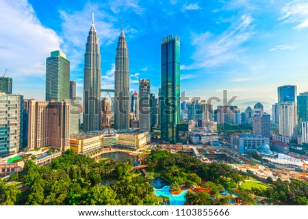 Kuala Lumpur, Malaysia -  May 14,2018 - Petronas Towers and KLCC.Petronas Towers is a high-rise building in Kuala Lumpur, Malaysia.This tower was built in 1998.height is 452 m. #1103855666
